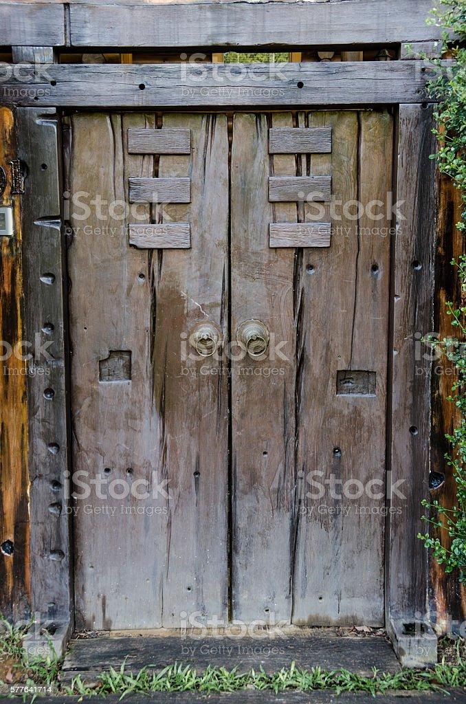 Brown ancient ruined wooden door stock photo