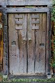 Brown ancient ruined wooden door