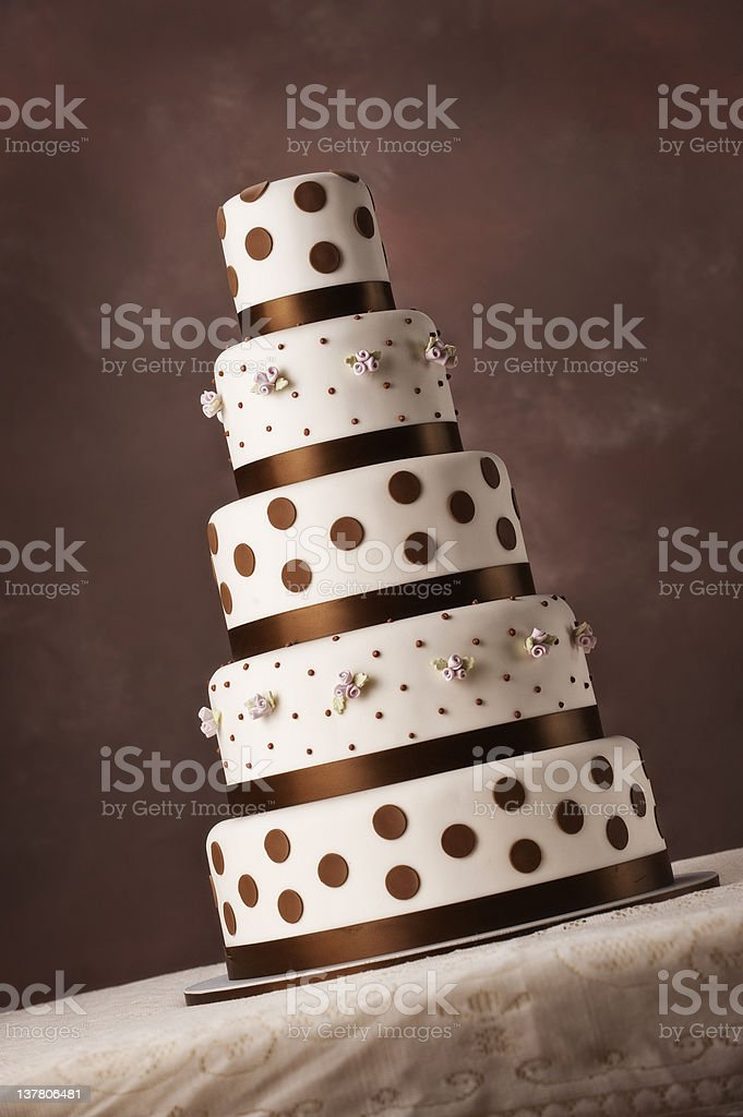 brown and creamy white 5 tier wedding cake stock photo