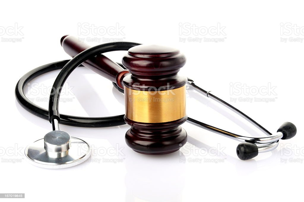 Brown and gold gavel with stethoscope stock photo