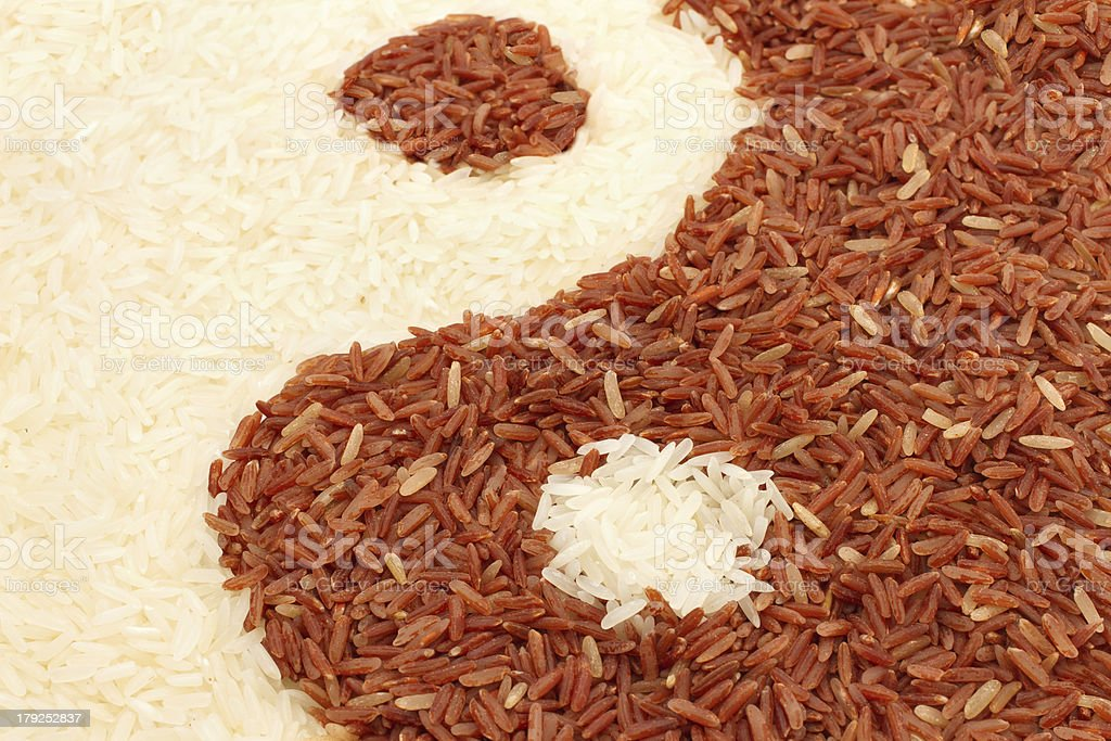 brown and jasmine rice  in yin-yang shape royalty-free stock photo