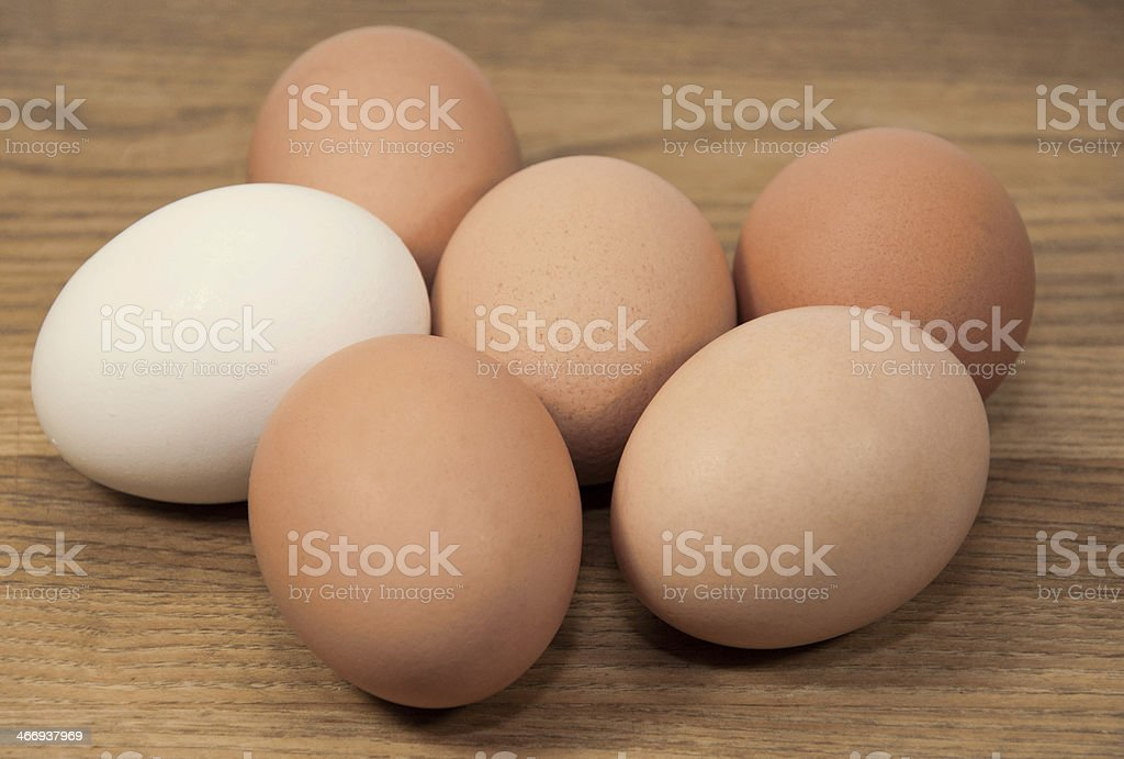 Brown and White Eggs on Grained Wood royalty-free stock photo