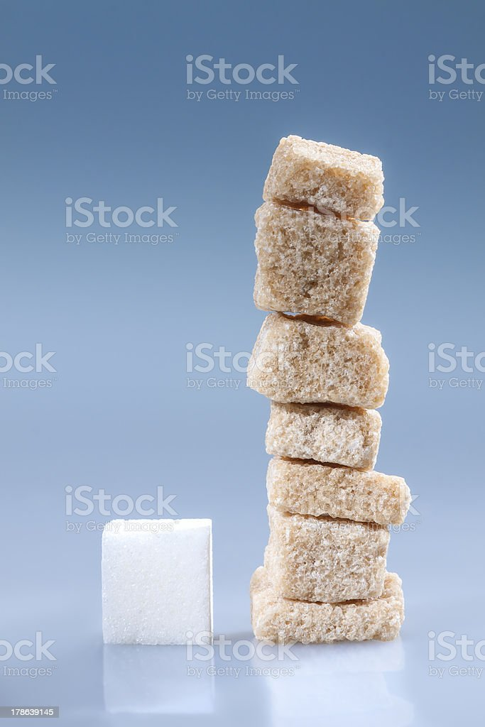 Brown and white sugar cubes. royalty-free stock photo