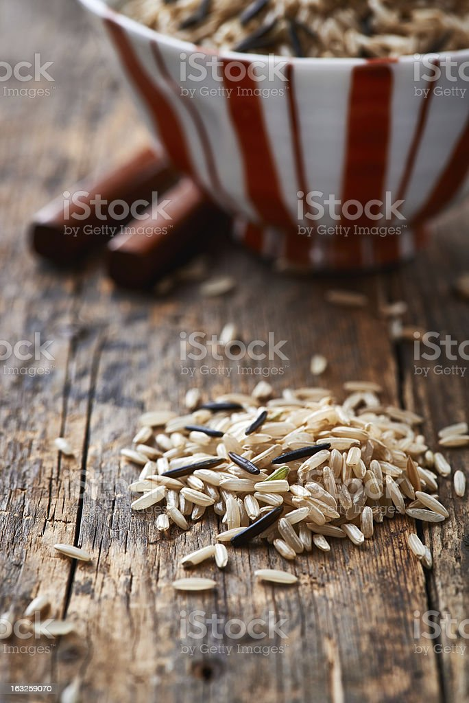 Brown and wild rice on wooden surface royalty-free stock photo