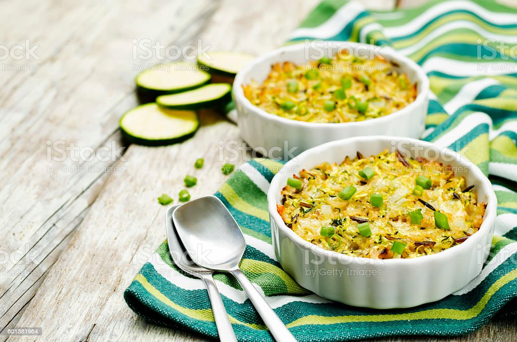Brown and wild rice zucchini casserole stock photo