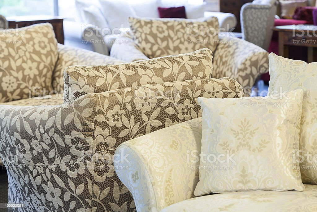 Brown armchairs and cream sofa royalty-free stock photo