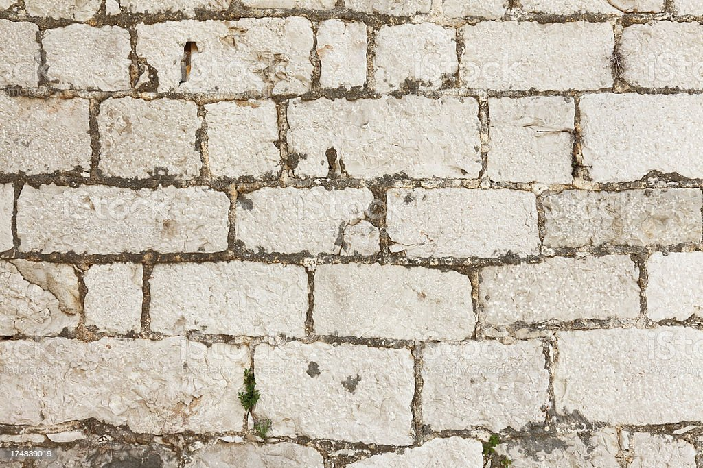 brown artificial rugged rock wall background Croatia royalty-free stock photo