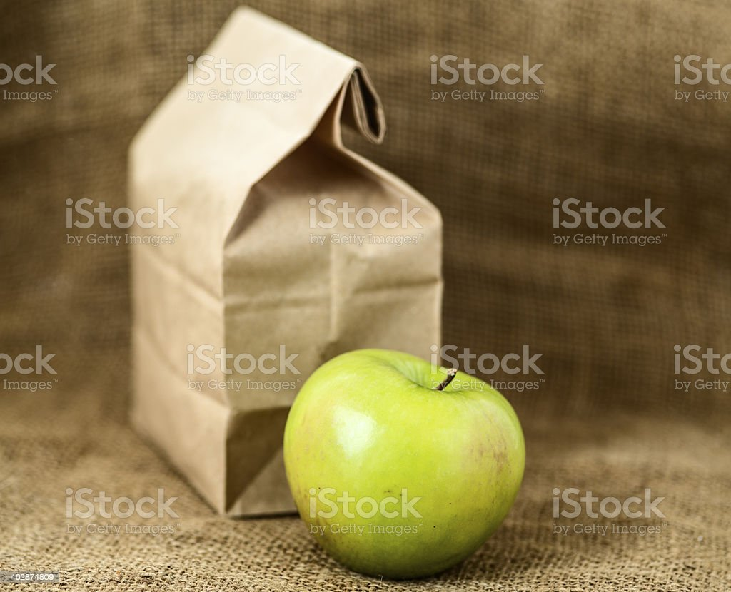 Brown bag lunch and apple stock photo