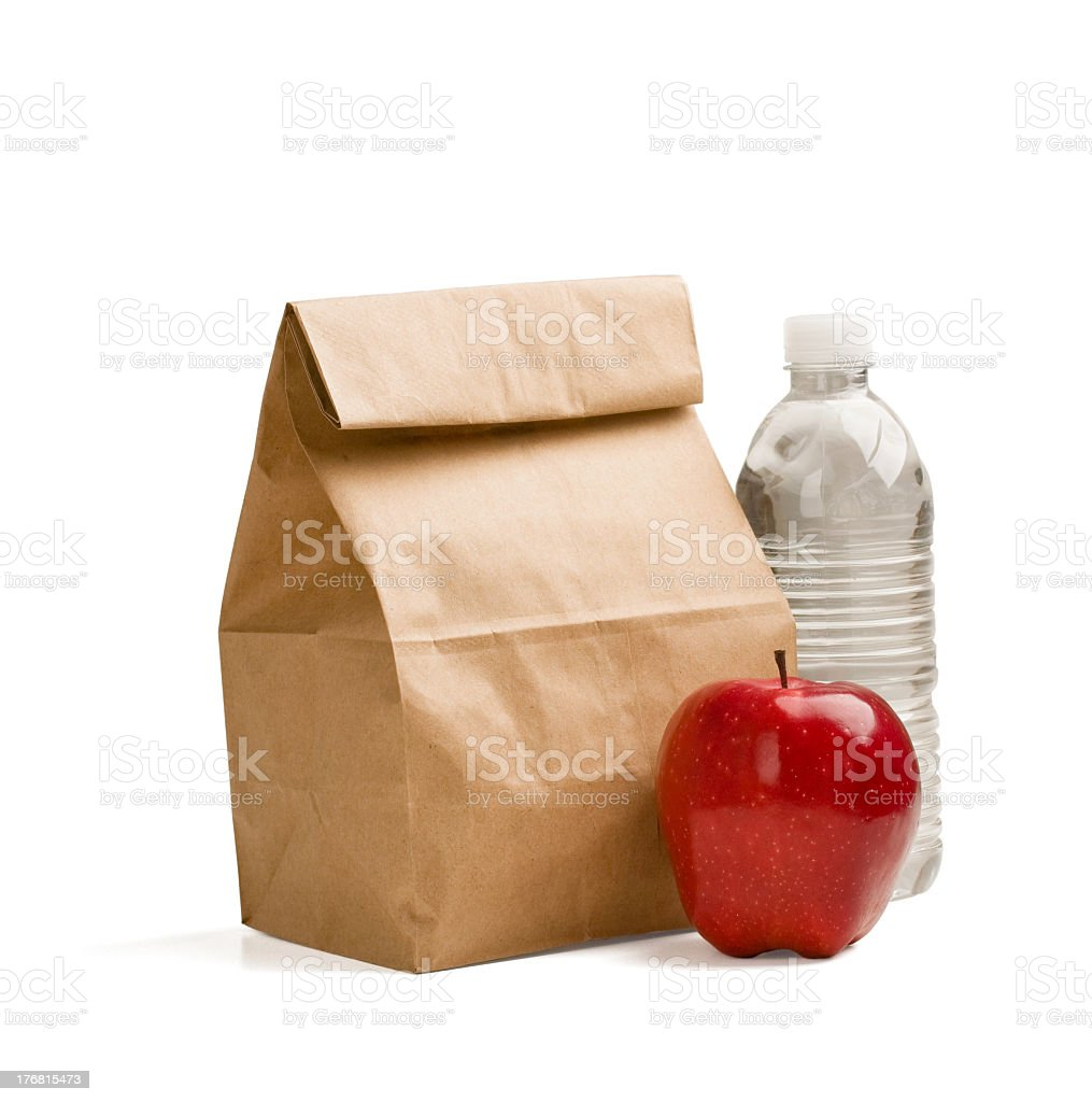 Brown bag lunch with red apple and water bottle stock photo