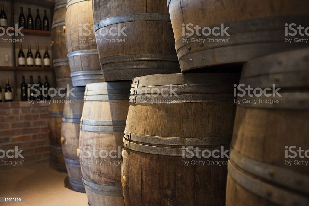 Brown barrels of wine stacked on top of eachother royalty-free stock photo