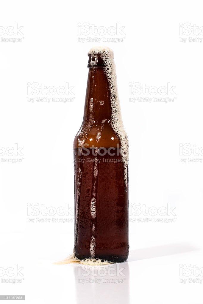 Brown Beer Bottle Overflowing stock photo