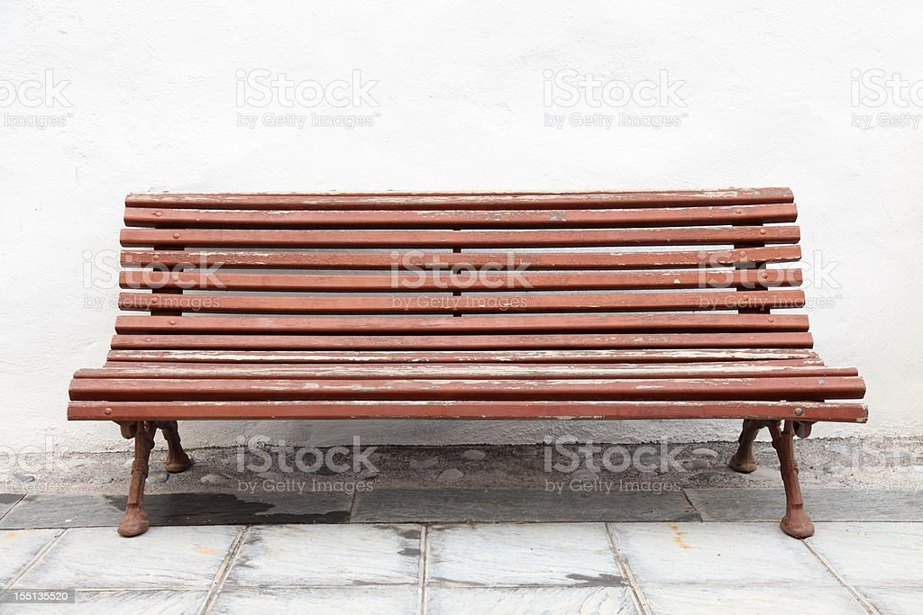 brown bench against house facade royalty-free stock photo
