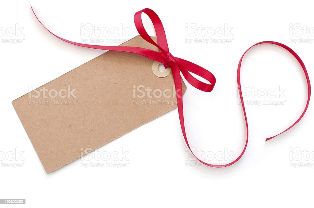 Brown blank gift tag with red ribbon on white background royalty-free stock photo