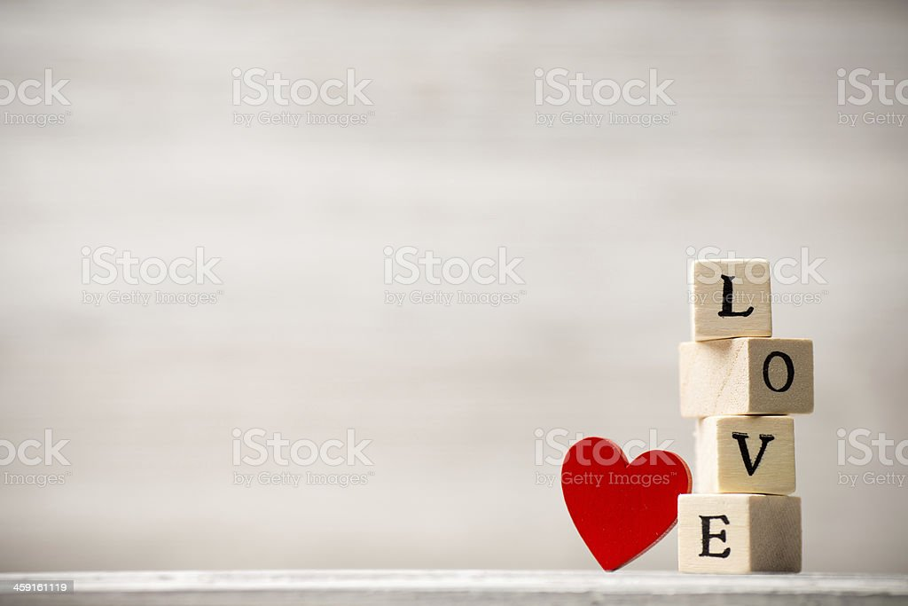 Brown blocks stacked on top of each other spelling love stock photo