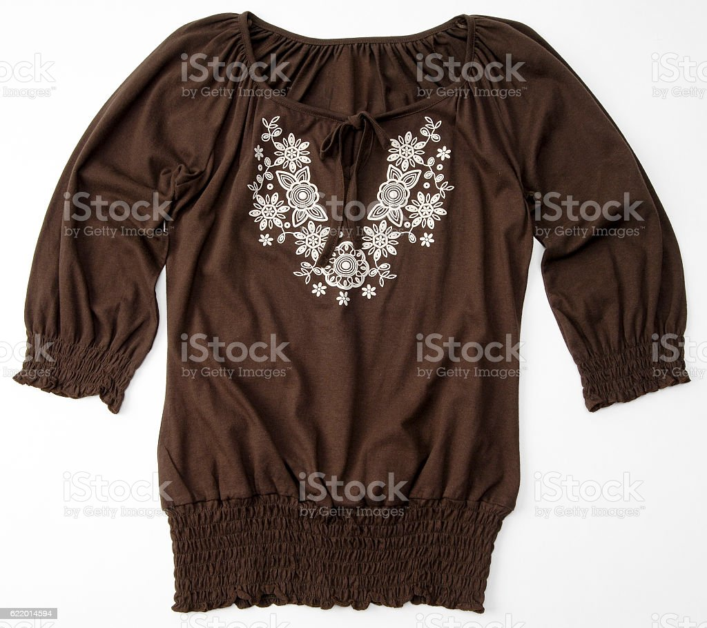 Brown blouse/shirt with floral design stock photo