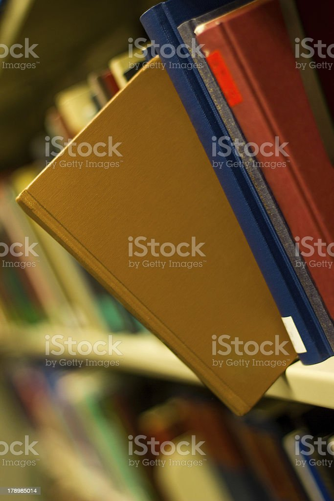 brown book popping out a bookshelf royalty-free stock photo