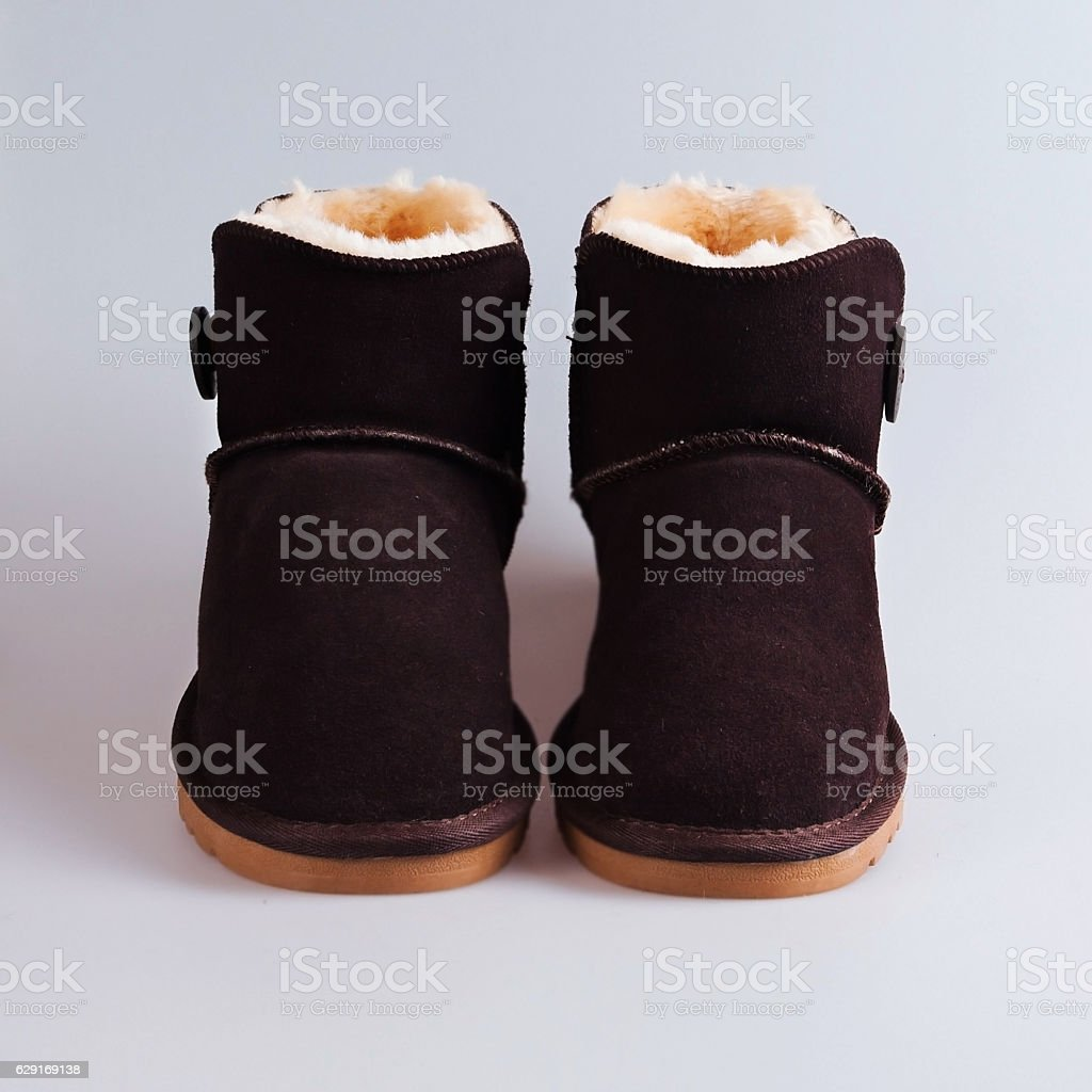 brown boots over white stock photo