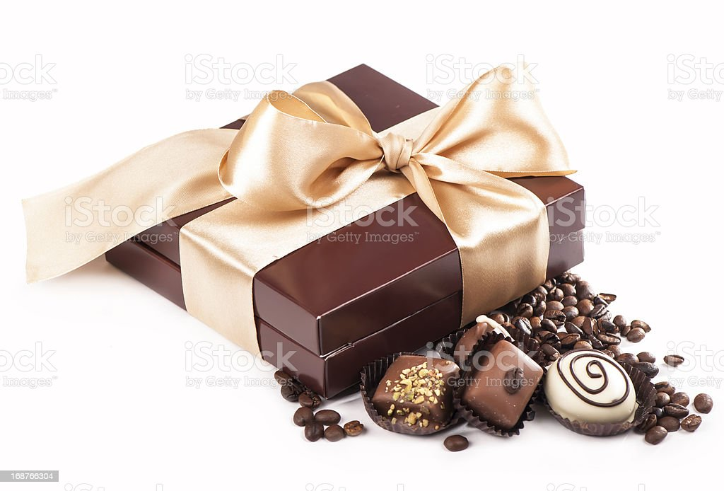 brown box with candies and golden tape, coffee grains royalty-free stock photo