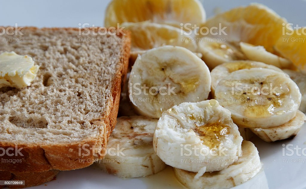 brown bread with butter and banana slices stock photo