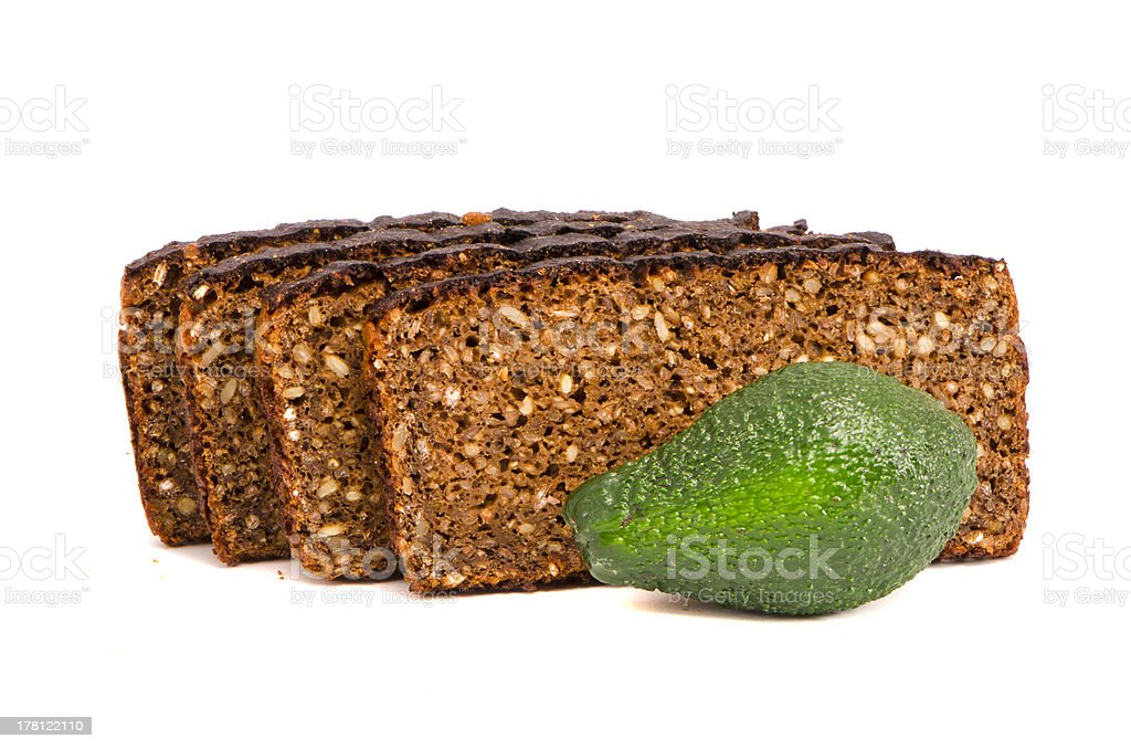 brown bread with grains slice and avocado on white royalty-free stock photo