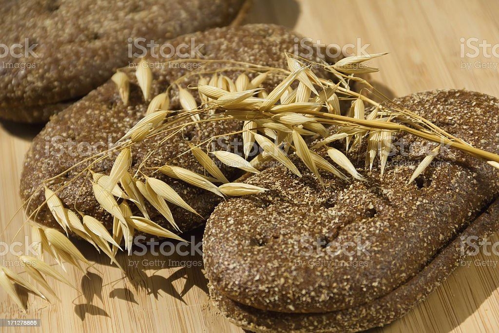 brown bread with wheat  spikelets stock photo
