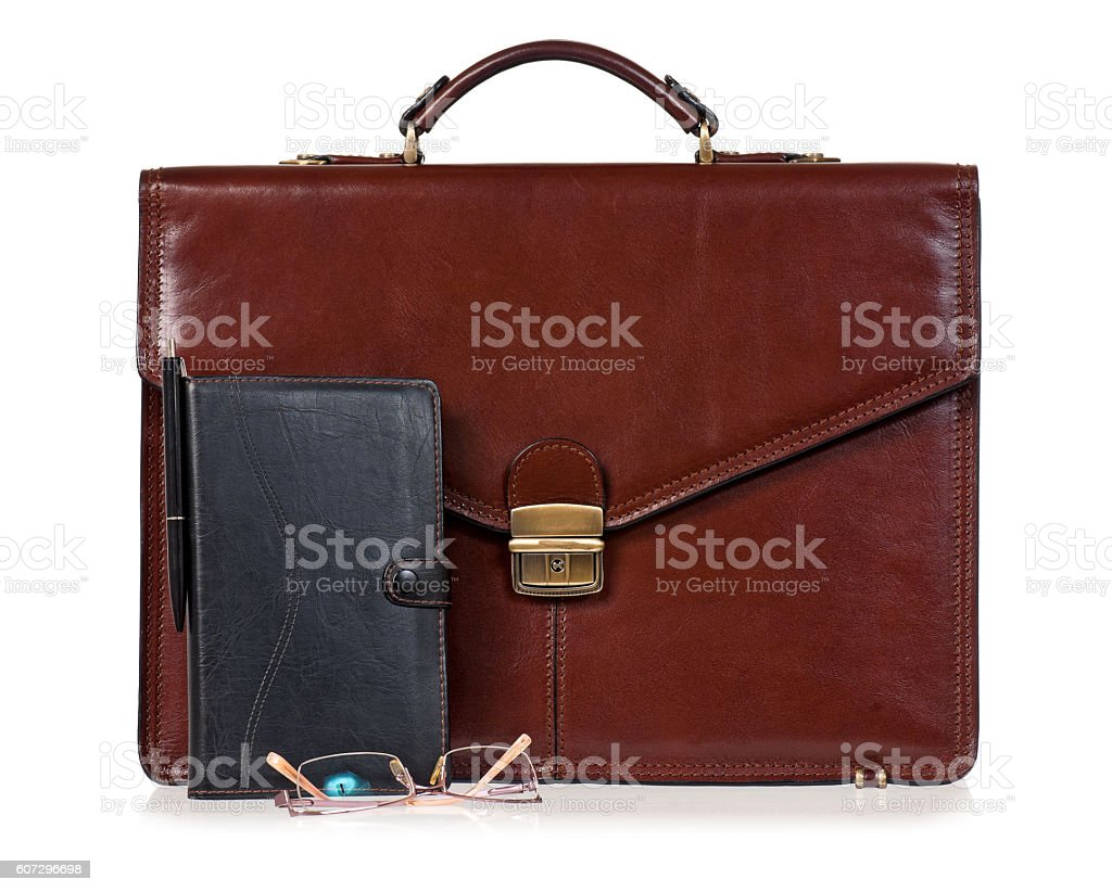Brown briefcase with accessories stock photo