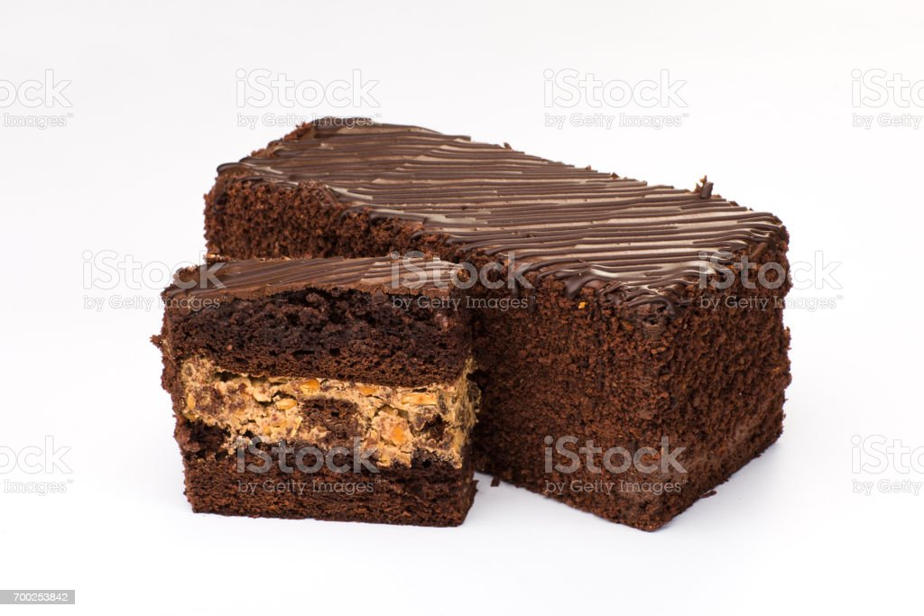 Brown cake with cream filling with fruit and chocolate stock photo
