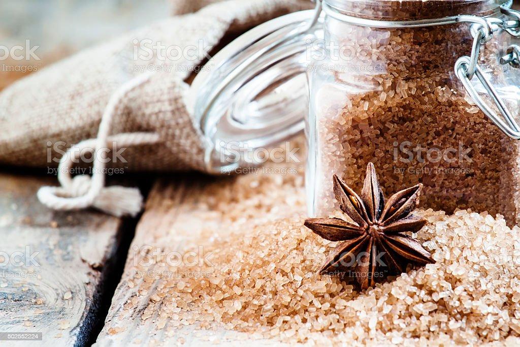 Brown cane sugar in bags made of burlap stock photo