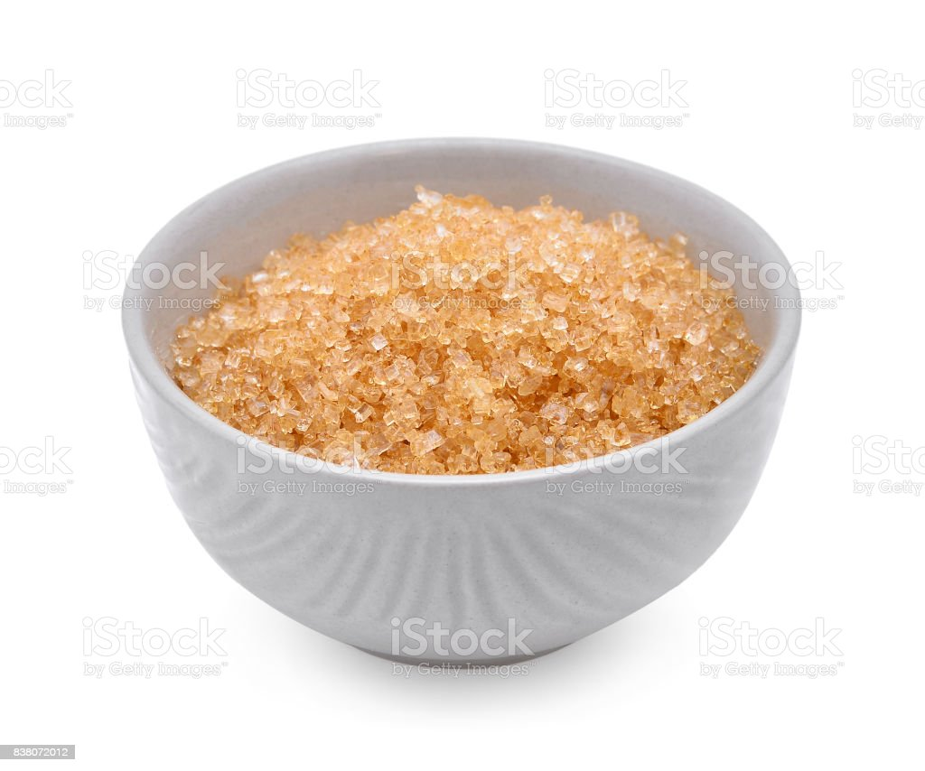brown cane sugar in white cup isolated on white background stock photo