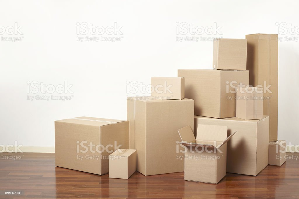 Brown cardboard boxes of various sizes piled together stock photo