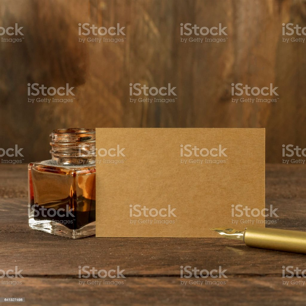 Brown cardboard business card with ink and pen stock photo