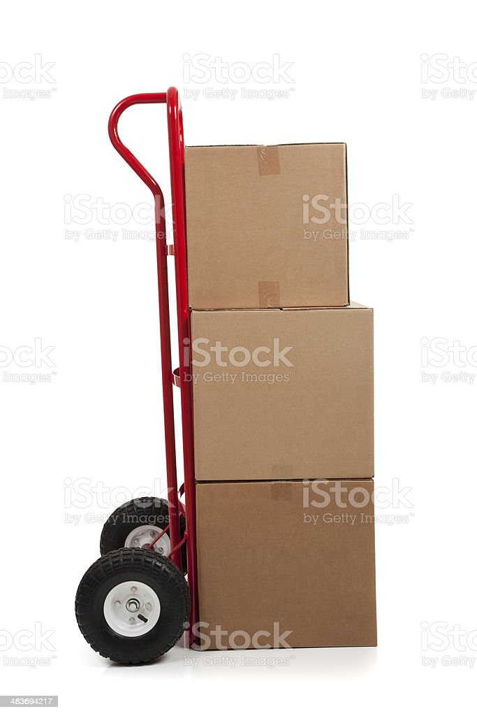 Brown cardboard moving box on white with a fragile sticker stock photo