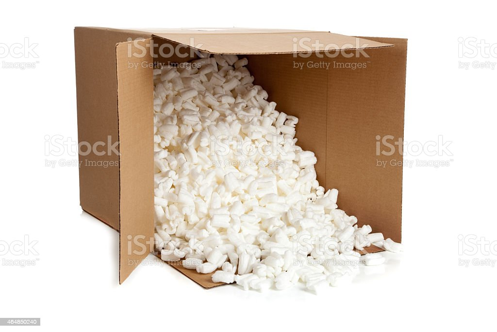 Brown, cardboard moving box with styrofoam on white stock photo