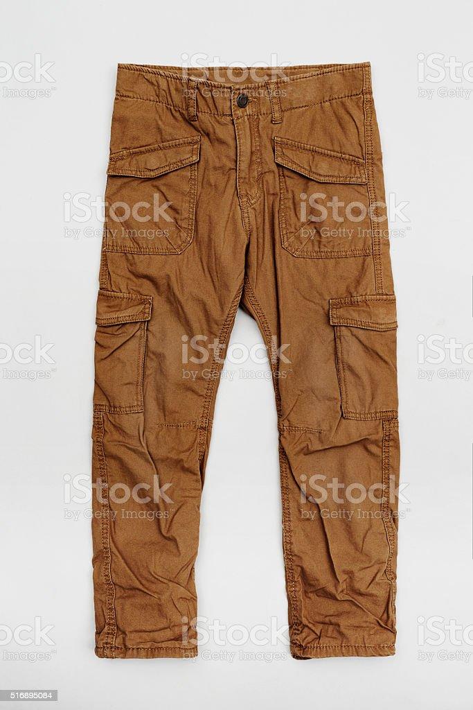 Brown cargo pants in white studio stock photo