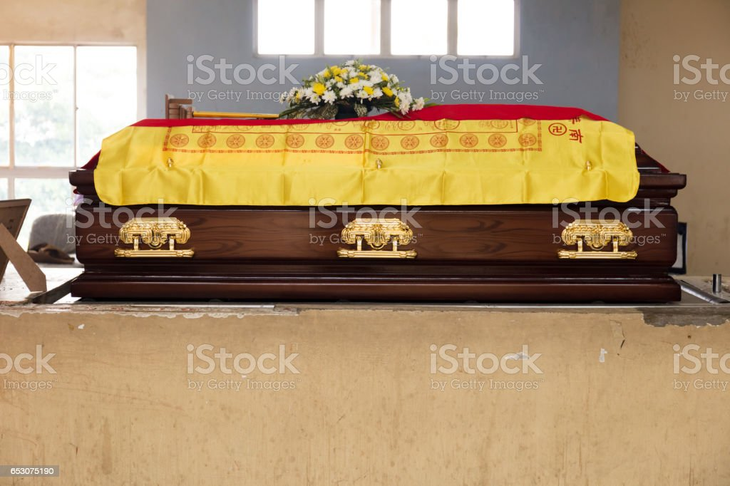 A brown Casket at a traditional Chinese funeral services stock photo