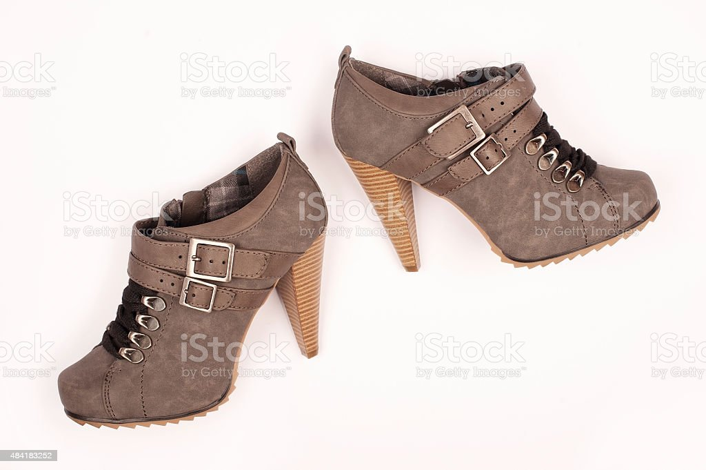 Brown chamois high heels fashionable female shoes stock photo
