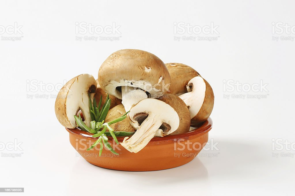 Brown champignon mushroom group in a ceramic bowl royalty-free stock photo