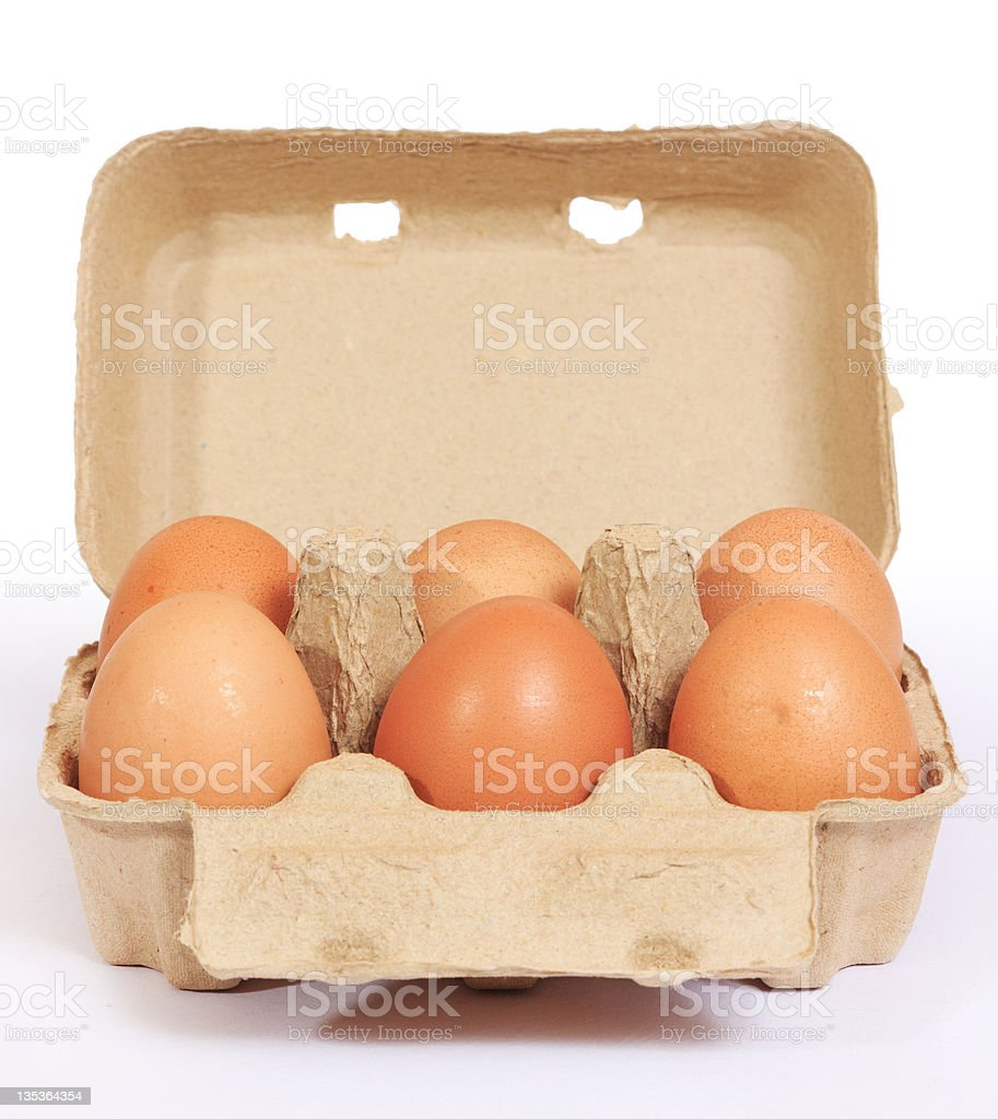 Brown chicken eggs in cardboard box container royalty-free stock photo