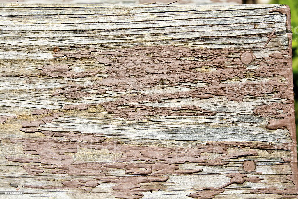 Brown chipped pain on wood royalty-free stock photo