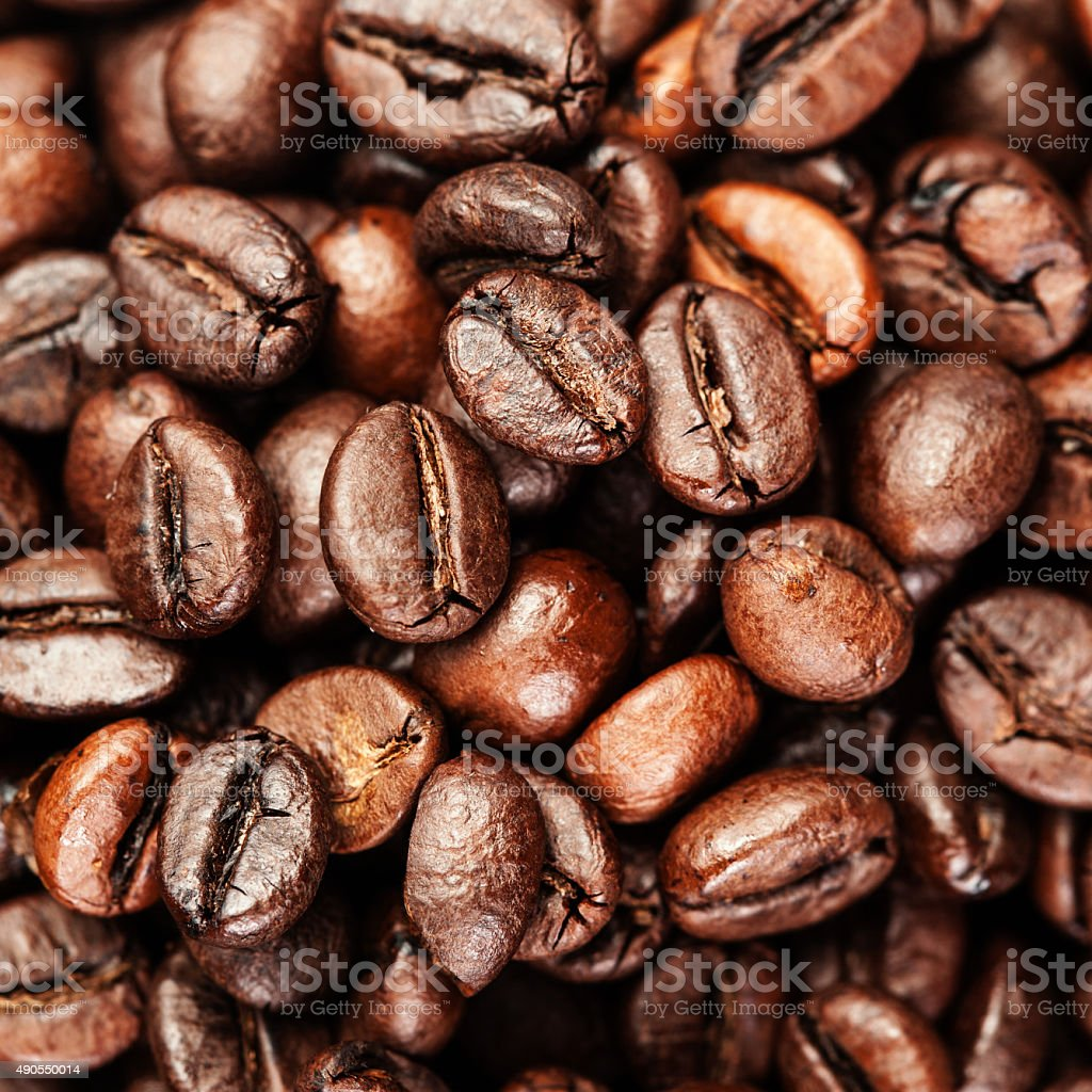 Brown coffee beans, close up of coffe bean for background stock photo