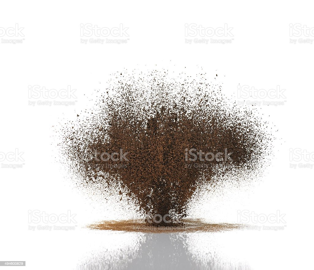 Brown coffee grinds suspended in the air stock photo