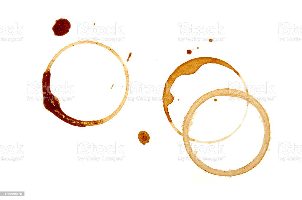 Brown coffee stains on a white surface stock photo
