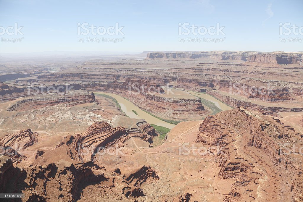 brown Colorado River bend from Dead Horse Point Utah USA stock photo