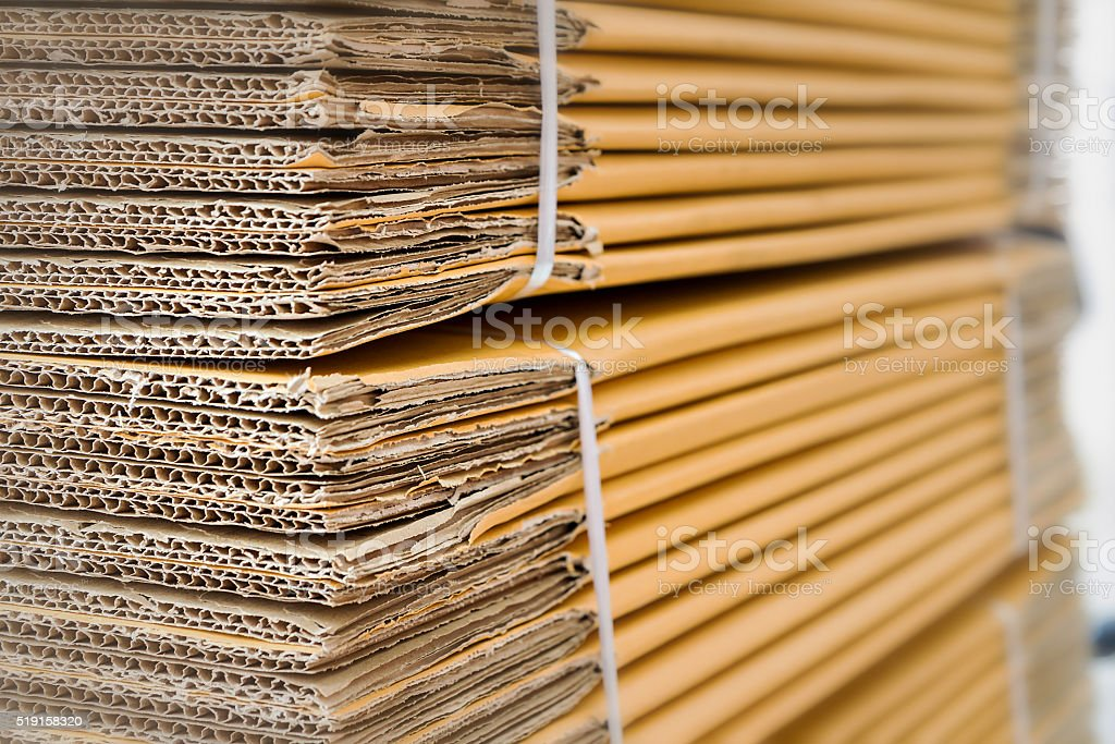 Brown corrugated cardboard with selective focus and blur effect stock photo