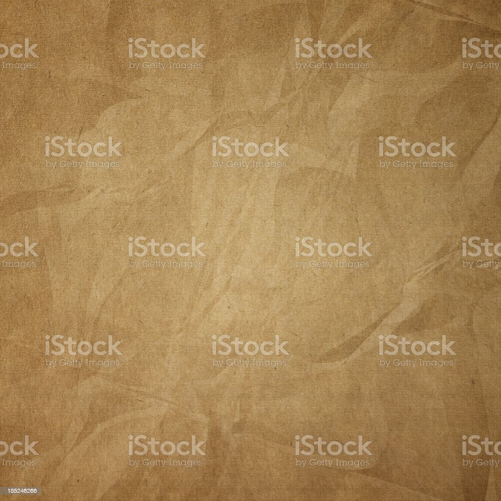 Brown crumpled craft paper texture  stock photo