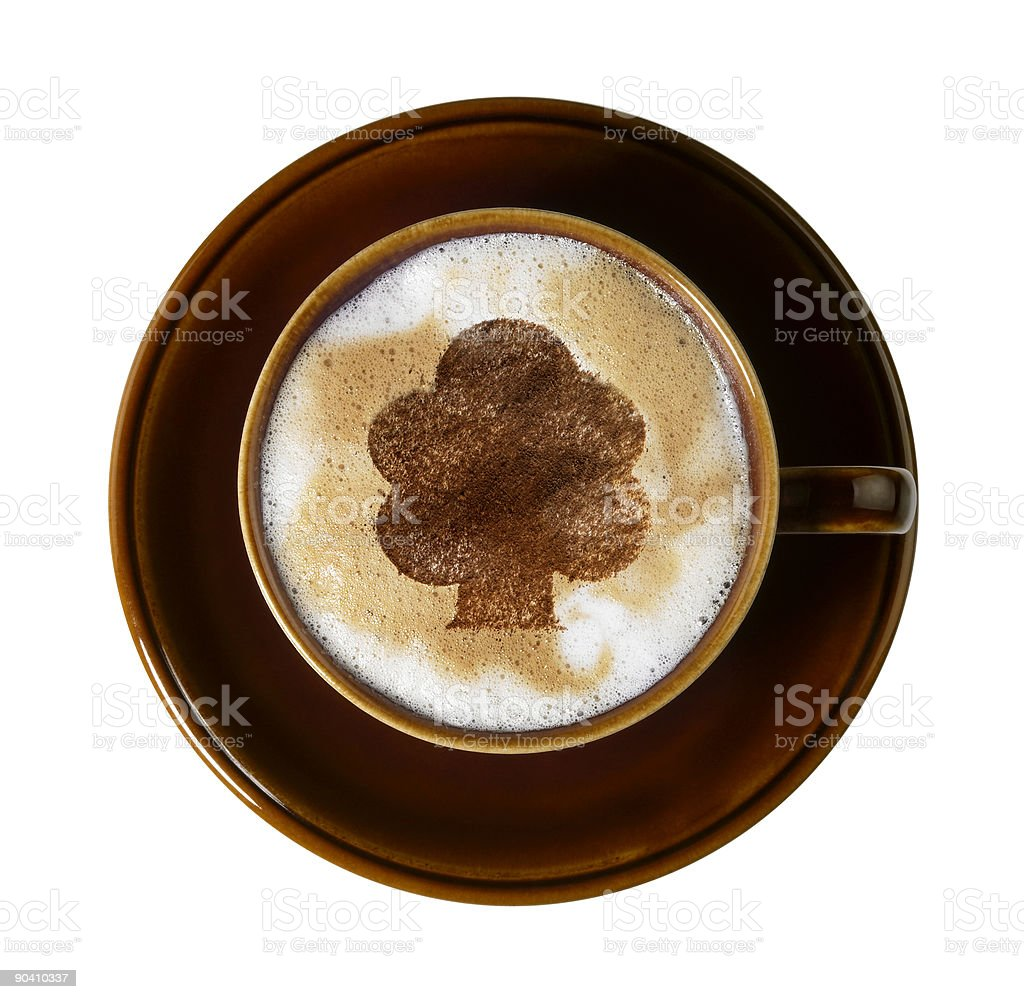 brown cup with chocolate tree on milk froth stock photo