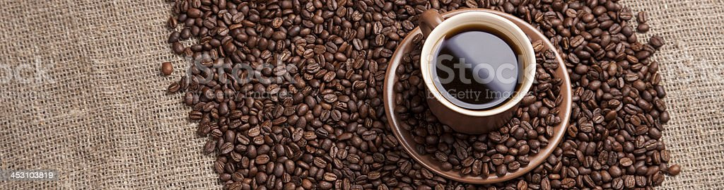 Brown cup with coffee on sackcloth royalty-free stock photo