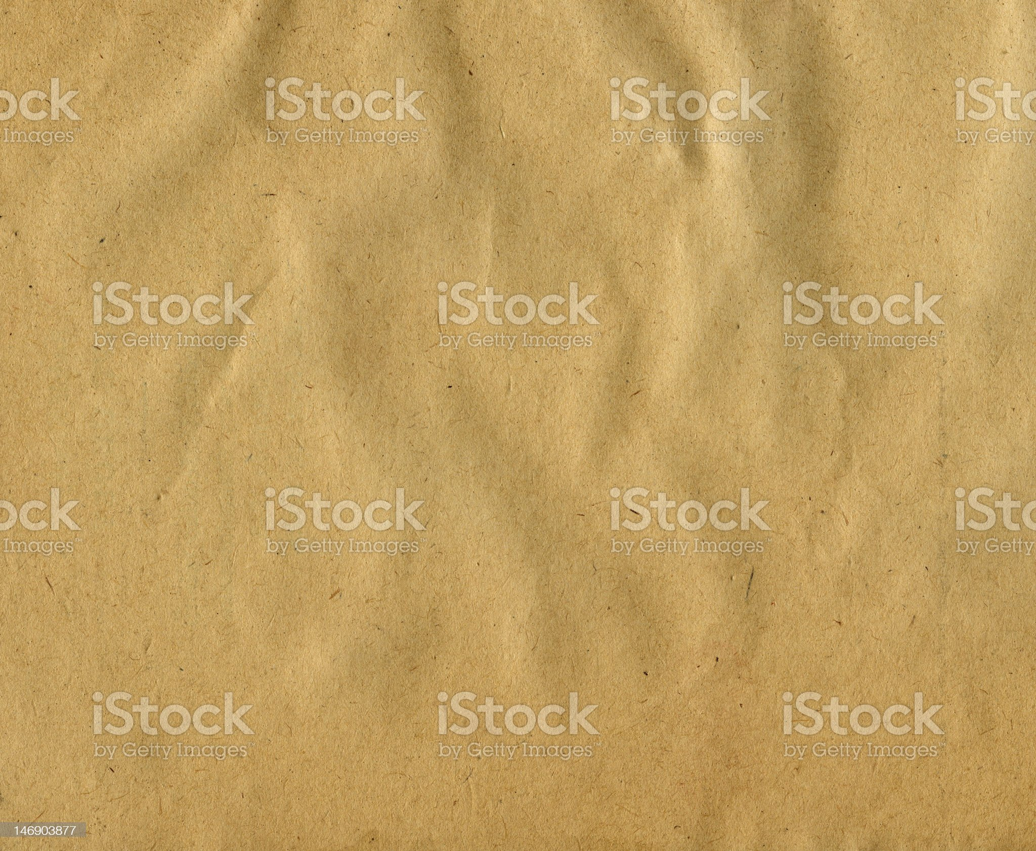 Brown damp corrugated paper background royalty-free stock photo