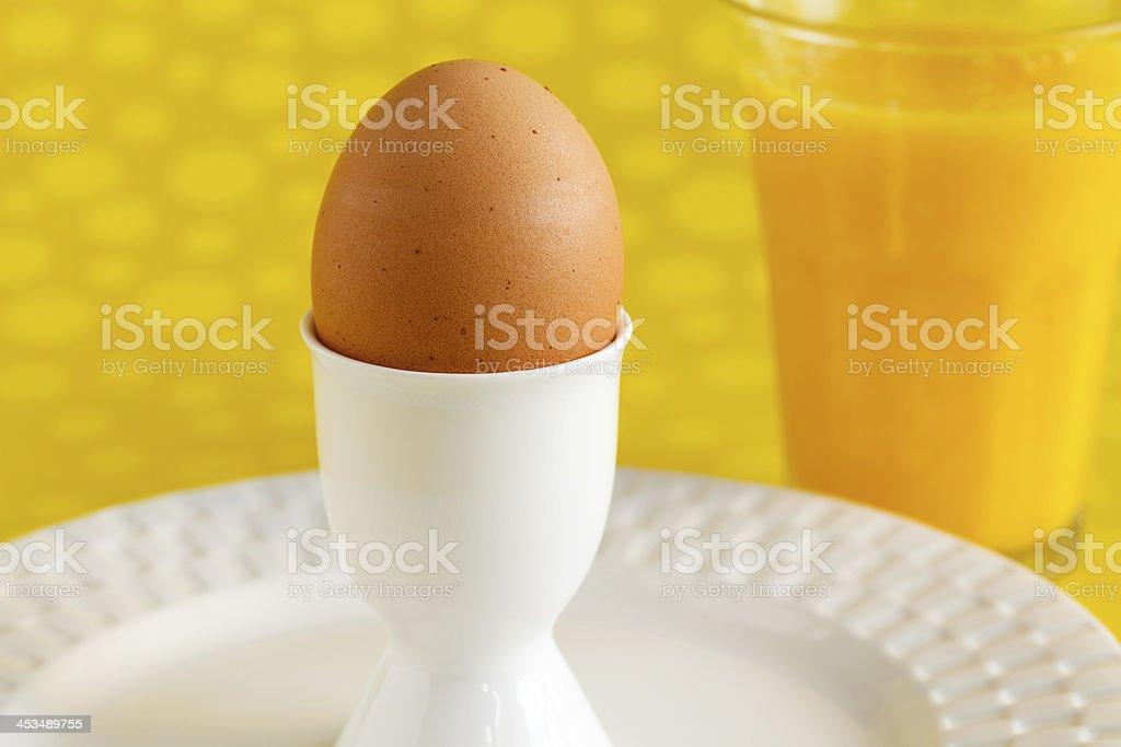 Brown Egg with Orange Juice royalty-free stock photo