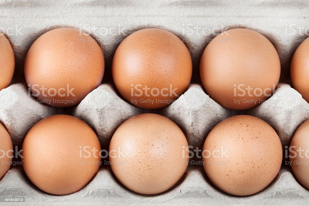 Brown eggs in a box stock photo